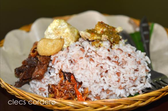 Andi Jaya's babi guling is served with brown rice.