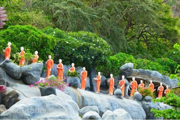 A long line of statue  monks depicting their daily routine.