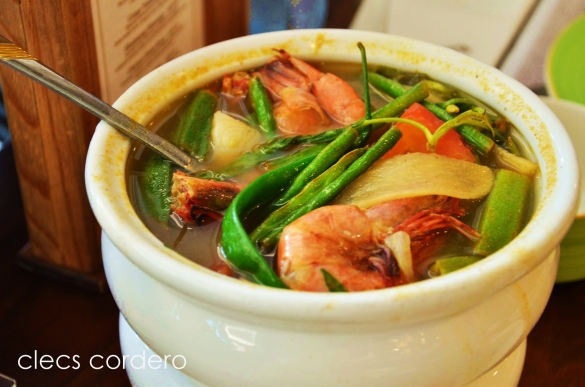 Sinigang na hipon - a tamarind flavored soup served with shrimps and assorted vegetables (Price: AED 38-full/ AED 20-half)