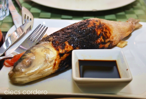 Inihaw na bangus - grilled milkfish stuffed with ingredients like onions, garlic, tomatoes etc.